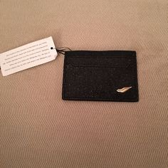 NWT card holder NWT Black Sparkly card hold that fits 4 credit cards and has a place for cash in middle! But you can double up the cards to fit more! I really think the sparkles make the whole thing! Offers Welcomed Accessories Key & Card Holders