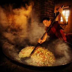 yamashitaphoto~~  Stir fry for 300 at Songzanlin Monastery, Benzilan, #Yunnan, #China: Mushroom, tomatoes, carrots and potatoes served atop rice will be the main meal of the day after monks morning meditation. @Nat Geo @thephotosociety @songtsamlodges  #shangrila  #tibet