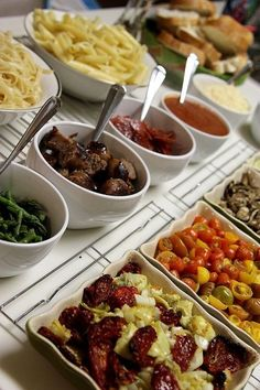 Pasta Bar -- chicken, steak, alfredo, marinara, pesto, sauteed mushrooms, steamed broccoli, red peppers, spinach and/or asparagus, grape tomatoes. garlic bread or bread sticks.   I love the idea of a meal you assemble  yourself at a get-together :)