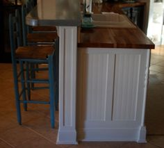 Beadboard: yes, Dark stained Butcher block: yes, Toe-stubber: no, Deeper bar top, Fancy lathe-turned trim: no