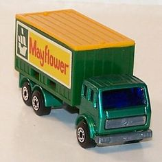 """A """"Matchbox"""" Mercedes truck with the Mayflower shipping company insignia on the side"""