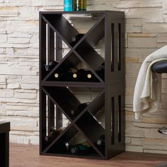 This free-standing wine rack showcases a convenient X-shaped structure that allows for multiple wine bottle storage. The slatted cut-outs along the side provide a peek into the stored items while enha