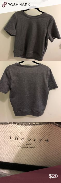 Theory basic top Theory top in gray. Size small but has a loose boxy fit. Flattering on on body types. Good basic! Theory Tops