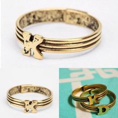 """stackable 'K' initial ring gold adjustable initial ring. Includes one """"K"""" ring. Can be worn and purchased together or separate. Never worn once in perfect condition. PayPal/swaps/trades NOT accepted. price if firm. Not accepting offers at this time. thanks. Urban Outfitters Jewelry Rings"""