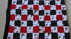 YOU ARE LOOKING AT A HANDMADE QUILT!  THIS WOULD BE GREAT GIFT FOR THAT FALCONS FAN IN YOUR LIFE EVEN IF IT YOU!! IT MEASURES AROUND 72 WIDE AND 88 LONG  IT IS HAND MADE AND IT COMES FROM A SMOKE/PET FREE HOME!! I HAVE A LOT OF TIME AND LOVE IN THIS QUILT AND IT IS A VERY NICE PRODUCT!!! THANKS FOR LOOKING AND IF YOU HAVE ANY QUESTIONS PLEASE ASK!!! THE BACKING IS BLACK .THIS BLANKET IS MACHINE WASHABLE AND DRYER FRIENDLY ... DRY AT LOW HEAT..