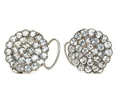 """This pair of Georgian earrings still retains its original back to front ear wires with what is termed """"wig loops"""". In a floral cluster form, these antique earrings characteristically are foiled and set closed back in low grade silver. The pastes are cut in such a manner as to pick up the ambient light from the candles which typically illuminated 18th century indoor spaces. Aren't you thrilled to know some treasures survive?  Date: Circa 1780."""