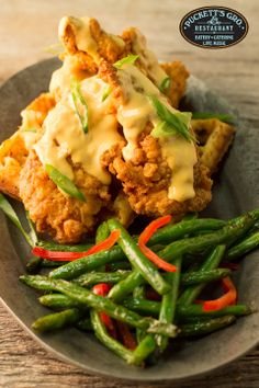 Featured during #NashvilleOriginals #RestaurantWeek January 2014- #NashvilleOriginals #RestaurantWeek is one of our favorite times of the year at Puckett's. It allows us to have fun with our menu and revisit some of our favorite specials. This is twist on one of those faves, firecracker chicken. Firecracker Chicken & Waffles,  crispy chicken tenders on top of a Cajun cornbread waffle, topped with firecracker gravy. Served with flat iron green beans.