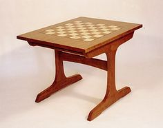 """The board is solid wood, 3/4"""" thick. Includes a shelf for games. Fine handmade wooden furniture by Joseph van Benten Furnituremakers in Brookline, Massachusetts."""