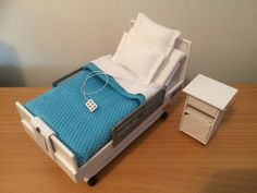 A personal favourite from my Etsy shop https://www.etsy.com/uk/listing/252402370/dollshouse-handmade-hospital-bed-and
