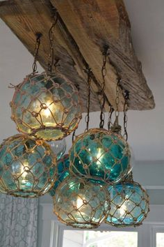 Fantastic for an oceanographers home or fantastical for fans of vintage glass fishing float light fixture chandelier with 7 floatslights aloadofball Choice Image
