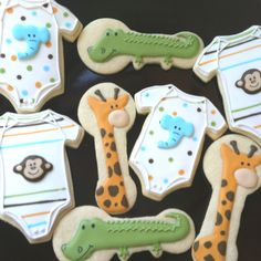 Boy baby shower Onesie, alligator and giraffe animal theme cookies Baby Boy Cookies, Baby Shower Cookies, Onesie Cookies, Cookies Decorados, Galletas Cookies, Cupcakes, Cupcake Cookies, Sugar Cookies, Iced Cookies