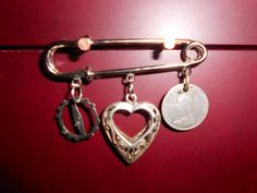 Kilt Pin with Vintage Charms by SteampunkBlacksheep on Etsy, $55.00