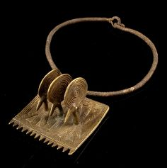 Africa | Amulet from Burkina Faso | Brass, with plant fiber | Est. 450 - 900€