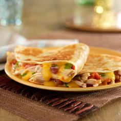 Cheesy quesadilla filled with shredded chicken and spicy tomatoes