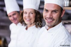Group of happy chefs smiling at the camera Chefs, Smile, Group, Happy, Dresses, Fashion, Pictures, Kitchens, Royalty Free Images