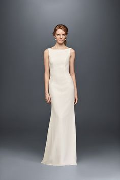 This high-neck wedding dress delivers serious back drama, with ruffles from the V-back to the hem. Exclusively at David's Bridal