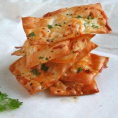 Parmesan Wonton Crackers. Lay 25 wonton wrappers pieces out in a single layer on a baking sheet. Brush with 1/2 c olive oil and lightly sprinkle with 1 C parmesan cheese, 1/2 C cilantro, salt and pepper. Bake at 375 for 8-10 minutes or until wontons are brown and crispy. Serve immediately or store in an airtight container for 3-4 days.