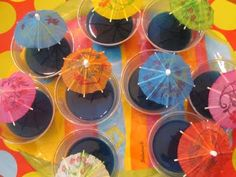 Using blueberry flavored Jello, we added Red Fish candy to the Jello.  Stuck in a parasol pick and the kids loved these!