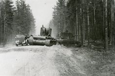 Soviet heavy tanks KV-2 from the 18th tank division of the 7th mechanized corps, abandoned during the retreat of the red Army on the dirt road Senno-Bogushevsk (Vitebsk region, Belarusian SSR). Next to cars passing German car Horch 901 (Kfz.12).1941.