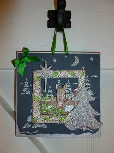 'Donkey at the Gate' hanging wall plaque, front.  Imagination Craft's - 'Christmas Tree' MDF Charm Kit. Silver Gilt Sparkle Medium. Donkey decoupage stamp set. Christmas dove decoupage stamp set White shimmer Sparkle Medium. Jet MDF paint.'Winter Wonderland' stencil.Silver embossing powder.  June 2013.
