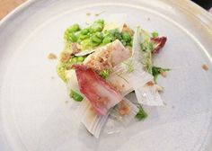 Bornholm cockerel with white aspararus and red endive leaves, over fresh peas and mint, Kadeau, Copenhagen // FoodNouveau.com