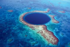 "The ""Great Blue Hole"" off the coast of Belize is known as one of the top 10 scuba diving sites in the world. You'll get a feel for this sea of turquoise at the Belize Blue Hole Bar at the Travel + Leisure Global Bazaar—no snorkel required. Immerse yourself in this illuminated universe and sit around the curved bar and dive into authentic Mayan dishes and cocktails."