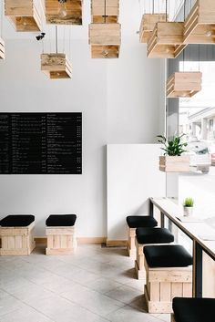 Juice bar interior II. Love the natural look for a juice bar - and the idea of keeping the window as a bar counter...