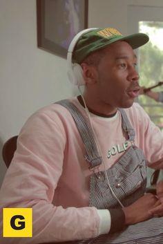Tyler The Creator wearing  Beats by Dre Solo² Headphones, Supreme World Famous Hat, Golfwang Logo Sweatshirt