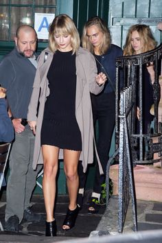 Leaving dinner in the West Village in Christian Louboutin booties with Cara Delevingne and Suki Waterhouse.