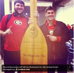 Austin Long & Aaron Murray with the Okefenokee Oar trophy after beating Florida again, 17-9. Go Dawgs!!
