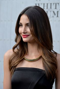 Lily Aldridge balanced her simple LBD with a sleek, statement gold collar necklace