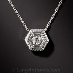 A bright white European-cut diamond sparkler centers a multi-tiered hexagonal setting, crafted in white gold by the famed Belais Bros, the first to make jewelry in the U. in that high-carat precious white metal. The new chain measures Art Deco Necklace, Art Deco Jewelry, Modern Jewelry, Fine Jewelry, Geometric Jewelry, Jewelry Ideas, Diamond Necklace Simple, Diamond Solitaire Necklace, Diamond Pendant Necklace