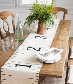 How to make a cute table runner out of a drab hardware-store dropcloth. #diyprojects
