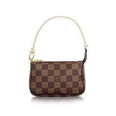 Discover Louis Vuitton Mini Pochette Accessoires  Whether it is clipped to another bag or carried independently, the Mini Pochette Accessoires in striking Damier canvas is a playful addition to any wardrobe.
