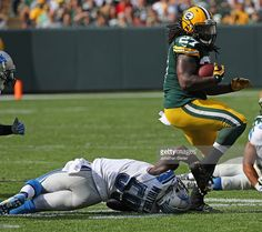 Eddie Lacy #27 of the Green Bay Packers breaks a tackle attempt by Tahir Whitehead #59 of the Detroit Lions at Lambeau Field on September 25, 2016 in Green Bay, Wisconsin. The Packers defeated the Lions 34-27.