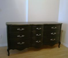 Black french provincial dresser with ornate antique nickel hardware