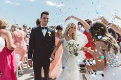 Confetti at your wedding is always a winner! Melbourne wedding at Elwood Beach. Bride wears Ania G bridal gown. Image by Vanessa Norris Photography