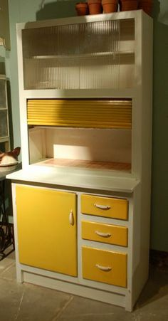 my Great Aunt had one of these. She would make us pancakes and set them on here for us to have. The rest would be stored in containers in here for later. I loved this cabinet, happy memories.