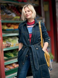 Pandora Sykes in a denim trench coat, sweater, and jeans // Free People