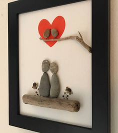Pebble Art-Couple-Love Birds Pebble art of couple sitting on driftwood with pebbles flowers on either side with two love birds on a branch inside a red heart. Frames in a black frame with outer dimensions 70 Favorite Rock Art Design Ideas Perfect For Begi Stone Crafts, Rock Crafts, Fun Crafts, Diy And Crafts, Arts And Crafts, Art Rupestre, Art Pierre, Pebble Pictures, Art Diy
