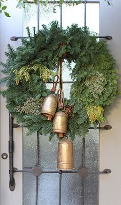 Wreath with bells. all green is still my favorite wreath...just mixed seasonal greenery. l love the bells.