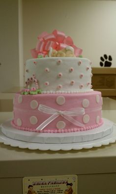 Girl baby shower cake - 8 & 6 inch layers, buttercream icing. Baby is made from gumpaste.