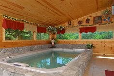 Skinny Dip Inn is a one bedroom, two story pool cabin that sleeps 4. This spacious luxury packed cabin is close to Dollywood, Splash County and all Pigeon Forge attractions.  Spend your vacation swimming in the indoor pool or sitting on the deck or in the hot tub.  Enjoy the full year round use of the pool swimming, exercising, or just relaxing in this heated adjustable hydraulic power unit that creates the swim current that you set. Gatlinburg/Pigeon Forge