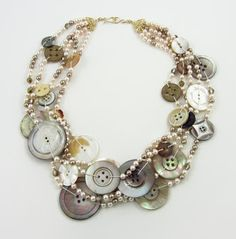 make necklace using old buttons and pearl necklaces: http://valerieaheck.blogspot.co.nz/2013/04/happy-anniversary-jewelry.html#.UeIQS9LX-So