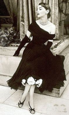 Margaret Phillips in a dress of black chiffon by Jean Desses, Vogue Oct. 1952