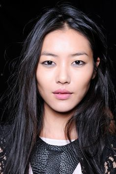 Model Liu Wen.  I like the pale lip color, definition of cheek bones, black lined eyes.  Might not be quite the summer look i'm going for though