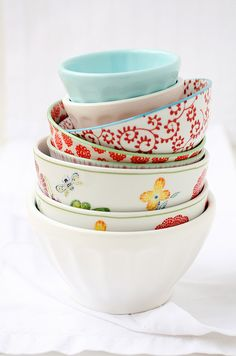 stack of bowls... my girls beg and beg for Anthropologie's cute bowls when we're at that store