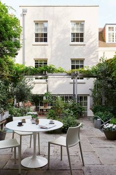Martin-Hulbert-designed housewhich is paved with reclaimed York stone. Martin designed the pergola and the planting is by Philip Edwards.