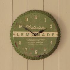 Pie tin clock. Love the vintage look.