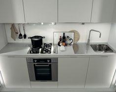 Detrás de las puertas se encuentra el fregadero, la estufa y el horno. Stove, Oven, Vessel Sink, Kitchen Design, Doors